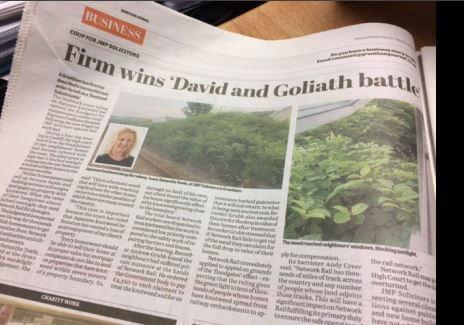 David and Goliath Headline in newspaper